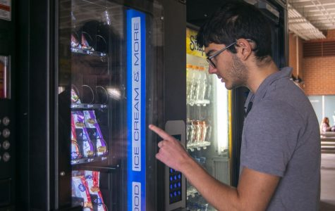 Students can't wait to get their treat from the new vending machine.