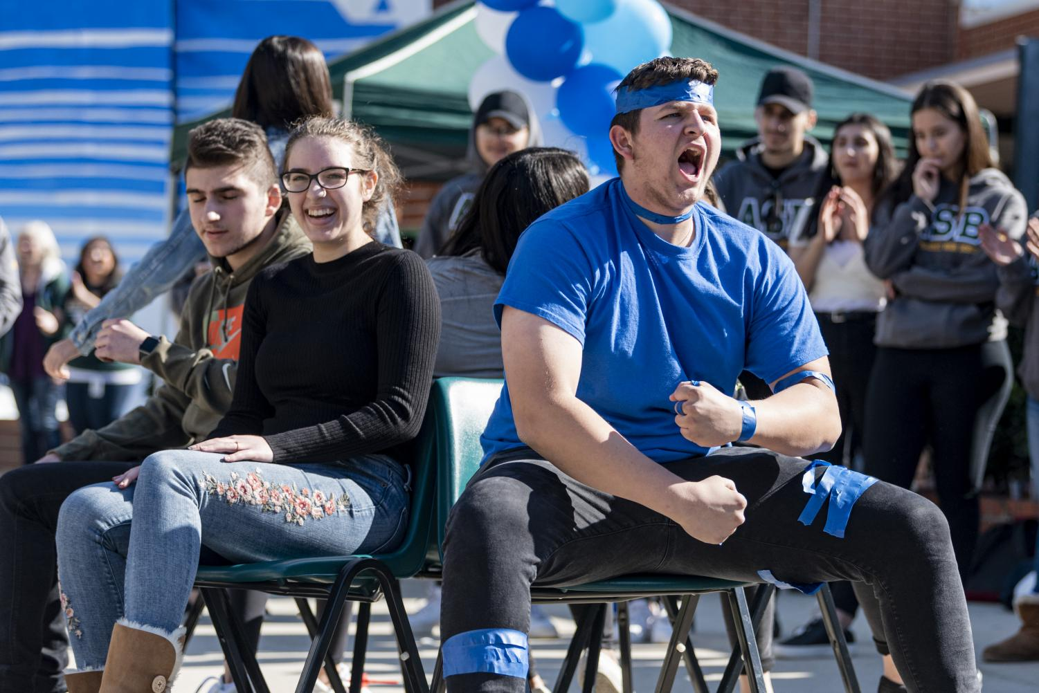 Students play musical chairs at the rally. The games were received with enthusiasm by many students.