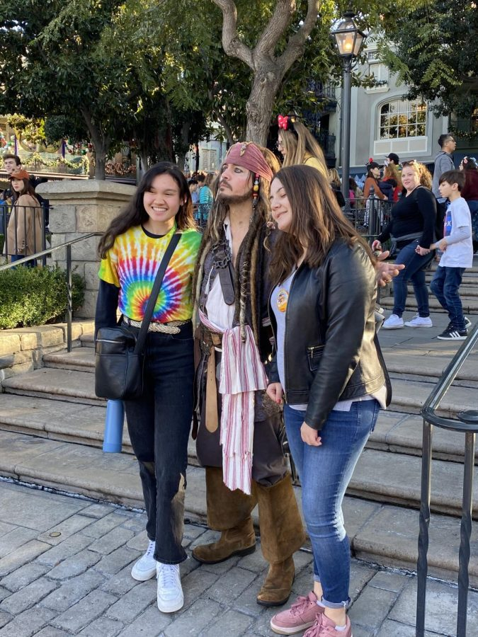 Allyson McCullagh and Emma Tsaturian pose with Captain Jack Sparrow while visiting Frontierland in Disneyland.