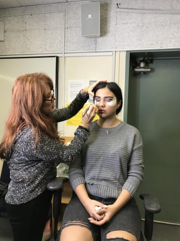 Instructor and makeup artist Michele Godinez demonstrates a natural-look on her model, Tatev.