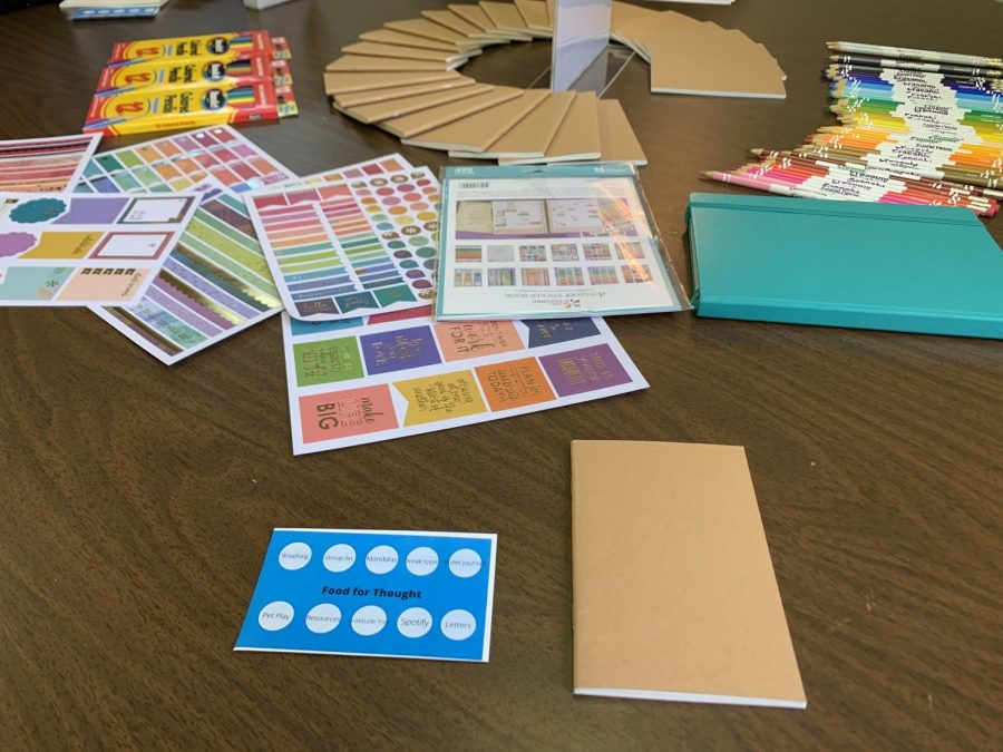 The bullet-journaling station consisted of mini dotted notebooks, stickers, and colored pencils.