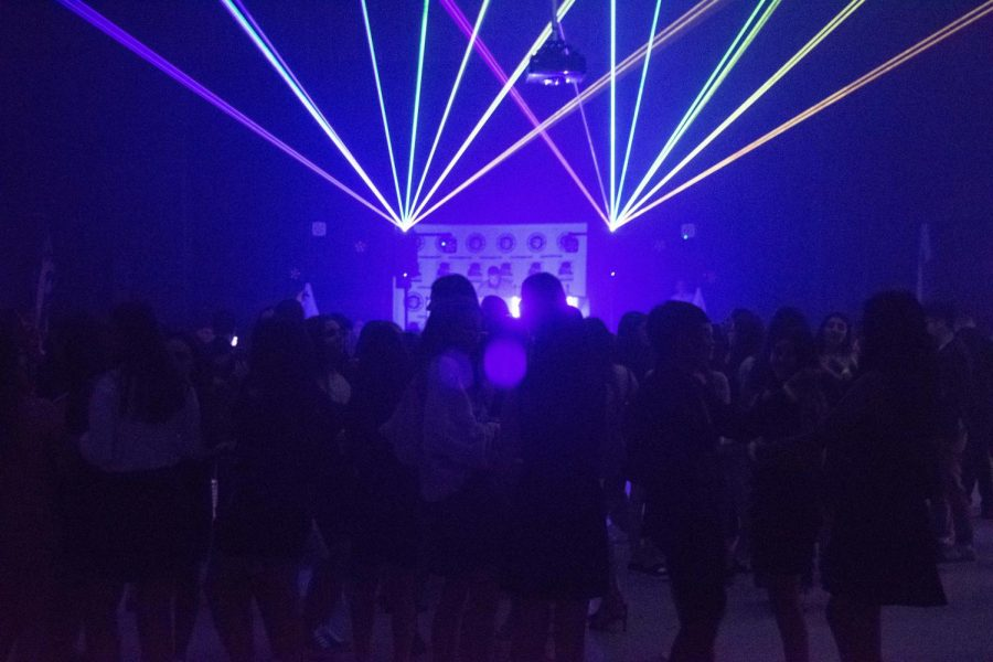 Strobe+lights+filled+the+auditorium+as+students+danced+to+the+music.