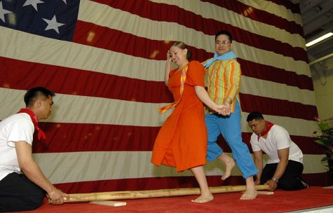 Two culinary specialists perform the Tinikling in honor of Asian-American Pacific Islander Heritage. The Tinikling folk dance originated in Palo, Layte.