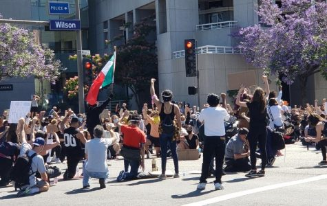 Protesters kneel in front of Glendale City Hall on Sunday, June 7, to protest again police brutality in light of George Floyd's murder.