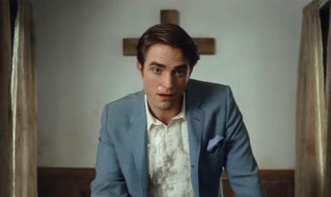 Robert Pattinson plays Rev. Preston Teagardin, the new unorthodox pastor of the small religious town in Ohio in 'The Devil All The Time'.