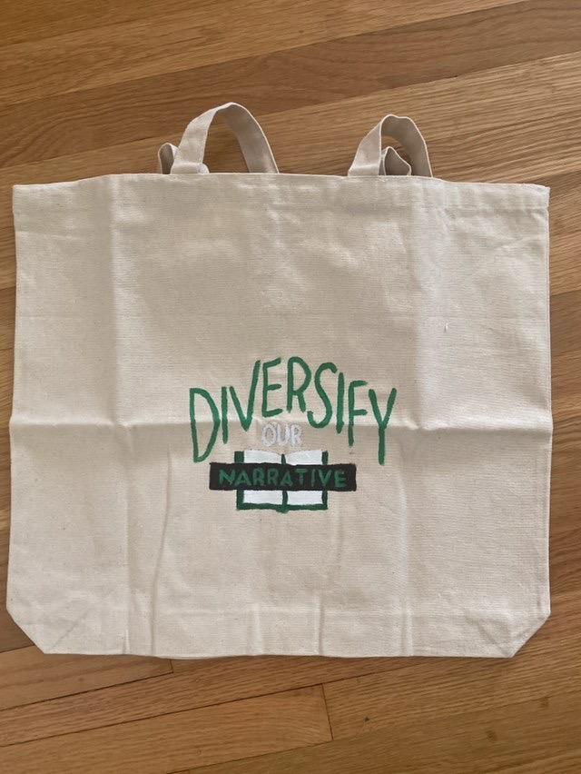 One of the organization's members, Parvaneh, made tote bags to give out to people who participate in the organization's giveaway.