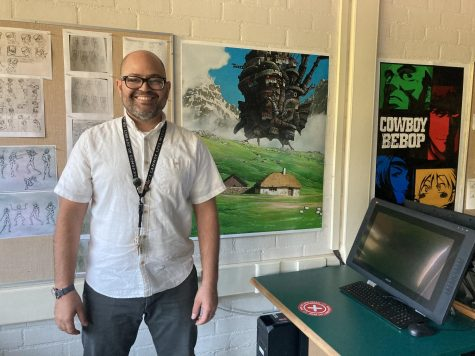 Computer Animation Teacher Anthony Lockhart teaches from his classroom on campus. He's decorated the classroom with animated media posters, like Howl's Moving Castle (center) and Cowboy Bebop (right), as well as figure drawings from class exercises (left).