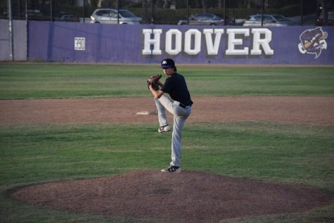 Ethan Tobey winds up to pitch for his team in a game last fall season. His sport was cut short because of lockdown in spring, and even with practice resuming soon, it will be even longer before proper games are played on the field again.