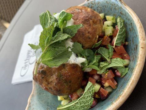 Morrocan meatballs are full of rich flavor with a pomegranate relish, cucumber and tomato salad, and topped with minted yogurt.
