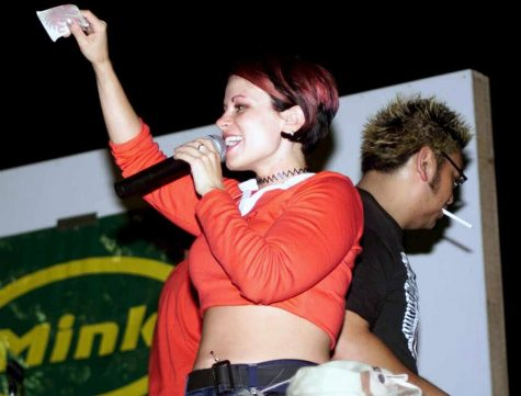Recording artist Jonda Madison from Mink performs at a USO concert.