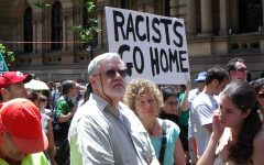 Anti-racism protesters in Sydney, Australia demand for people to change their opinions and end their xenophobia.